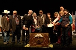 Adding the CCC's Expression of Reconciliation to the Bentwood Box at the 2014 TRC event in Edmonton.