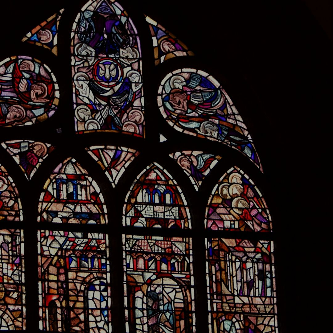 Stained glass window against black background