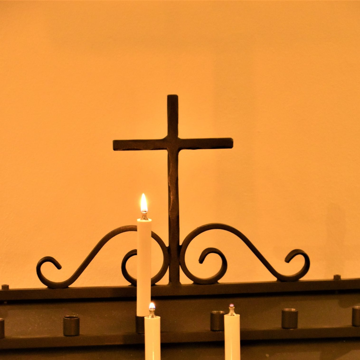 A cross with candles in a church